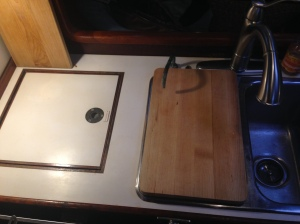 Icebox on the left. I have cutting boards everywhere; this one goes on top of one side of the sink.